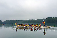 PDRAGON20P<br /> Team Dracarys paddles out to the start of their race during the first annual Bucks County Dragon Boat Festival on Lake Luxembourg at Core Creek Park Saturday September 19, 2015 in Langhorne, Pennsylvania.  The purpose of the event is to Paddle Out Hunger with proceeds benefitting Bucks County Housing Group. (William Thomas Cain/For The Inquirer)