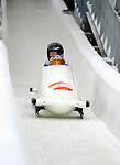18 December 2010: Victoria Tokovaya crosses the finish line, finishing in 11th place for Russia at the Viessmann FIBT World Cup Bobsled Championships on Mount Van Hoevenberg in Lake Placid, New York, USA. Mandatory Credit: Ed Wolfstein Photo