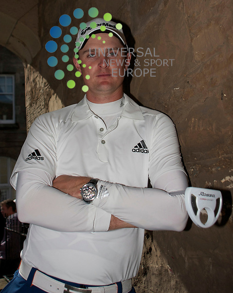 Golfer Justin Rose Adidas / Taylor Made Shop in the shop window  in St Andrews..12-07-10... English Golfer,  Justin Rose posesd today as a live mannequin in the shop window of.Auchterlonies golf store to celebrate TaylorMade-adidas Golf's countdown to.the 150th Open Championship..On The last Day of the T in the Park Music Festival, Balado...Picture, Mark Davison/Universal News and Sport.