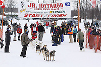Annika Oleson and dog team leaves the start line of the 2013 Junior Iditarod on Knik Lake.  Knik Alaska..Photo by Jeff Schultz/IditarodPhotos.com   Reproduction prohibited without written permission