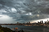 Ominous cumulonimbus clouds form over Manhattan and the Hudson River prior to a summer thunderstorm in New York City.