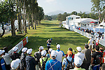 Damien Perrier of France tees off the first hole while the crowd of spectator watches during the 58th UBS Hong Kong Golf Open as part of the European Tour on 11 December 2016, at the Hong Kong Golf Club, Fanling, Hong Kong, China. Photo by Marcio Rodrigo Machado / Power Sport Images
