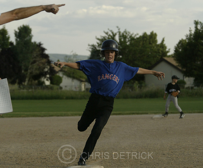Centerville, UT--24 Jun 2005--.**Close Up**.The Ranger's Ryan Dudley, 12, rounds third base to go onto score a run during the game. .The Rockies defeated the Rangers 7-4 in the 11-12 year old .Davis County Little League world series qualifying game Friday evening.  .Chris Detrick /Salt Lake Tribune.File #Little League CD04