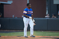 Jeremy Green (6) of Mooresville Post 66 returns to the dugout after hitting a home run against Kannapolis Post 115 during an American Legion baseball game at Northwest Cabarrus High School on May 30, 2019 in Concord, North Carolina. Mooresville Post 66 defeated Kannapolis Post 115 4-3. (Brian Westerholt/Four Seam Images)