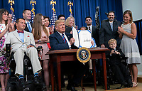 United States President Donald J. Trump signs S. 204, the &ldquo;Right to Try Act&rdquo; at the White House in Washington, DC, May 30, 2018.<br /> CAP/MPI/RS<br /> &copy;RS/MPI/Capital Pictures