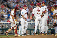 Florida State Seminoles head coach Mike Martin (11) walks to the mound against the Michigan Wolverines in Game 6 of the NCAA College World Series on June 17, 2019 at TD Ameritrade Park in Omaha, Nebraska. Michigan defeated Florida State 2-0. (Andrew Woolley/Four Seam Images)