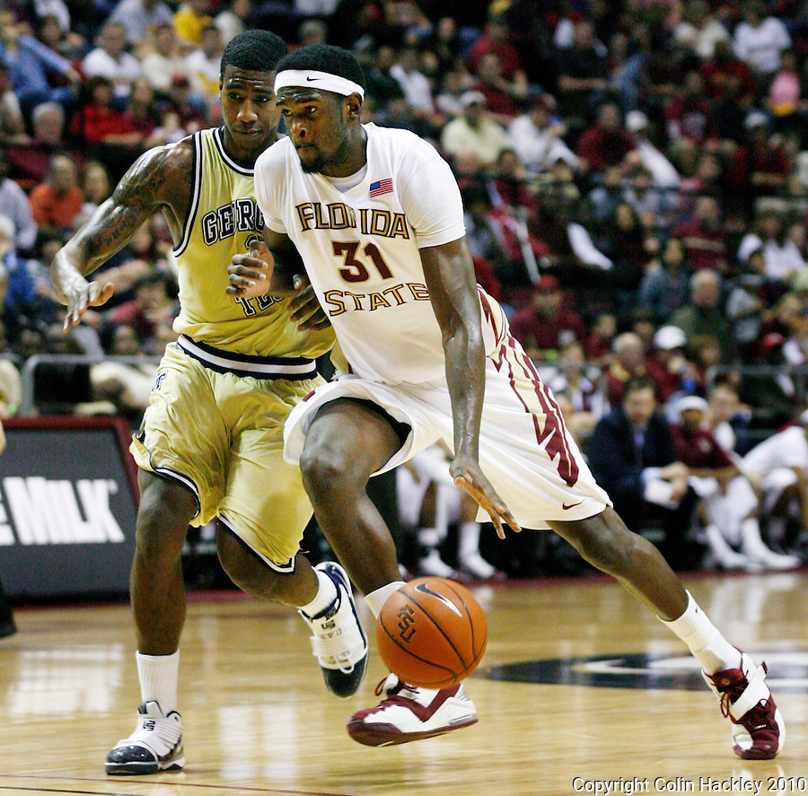 TALLAHASSEE, FL 1/24/10-FSU-GA. TECH MBB10 CH11-Florida State's Chris Singleton drives by Georgia Tech's Iman Shumpert during first half action Sunday at the Donald L. Tucker Center in Tallahassee...COLIN HACKLEY PHOTO