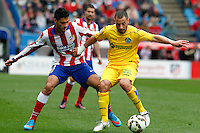 Getafe´s  midfielder Lacen and Atletico Madrid´s Mexican forward Raul Jimenez