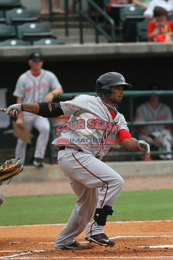 Greenville Drive designated hitter Keury De La Cruz #25 at bat during a game against the Charleston Riverdogs at Joseph P. Riley Jr. Park on July 17, 2012 in Charleston, South Carolina. Charleston defeated Greenville by the score of 5-0. (Robert Gurganus/Four Seam Images)