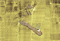 BNPS.co.uk (01202 558833)<br /> Pic: DanPascoe/BU/BNPS<br /> <br /> Digitised plan of Invincible on the sea bed..<br /> <br /> Fascinating artefacts salvaged from a historic gun ship which sunk off the British coast 261 years ago have gone on display for the first time.<br /> <br /> The French built ship is credited with transforming the Georgian Royal Navy after its capture in 1747 when trials revealed it was sleeker and better armed than British warships of the day.<br /> <br /> Unfortunately HMS Invincible  became wrecked on a shallow sand bank in the Solent in 1758 when en route to fhelp fight the French in Canada.<br /> <br /> The wreck, which is three nautical miles from Portsmouth, Hants, was first discovered by a fisherman in shallow 25ft waters 40 years ago. However, changing sea bed levels in the past few years have left it more exposed to the elements, leading to fears the relics could deteriorate.<br /> <br /> This prompted archaeologists to carry out a full scale excavation, with 1,458 dives taking place between 2017 and 2019 - during which nearly 2,000 artefacts were recovered.<br /> <br /> The array of new finds, including the ship's enormous cutwater - the forward curve of the ship's stem - have now been unveiled at the MAST Archaeological Centre in Poole, Dorset. They will eventually go on display at the National Museum of the Royal Navy in Portsmouth.<br /> <br /> Mr Pascoe said the HMS Invincible's innovative longer, streamlined design was copied by the British who adopted it on their ships up until the Battle of Trafalgar (1805).