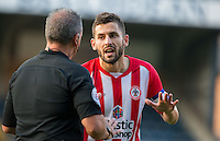 Seamus Conneely of Accrington Stanley has words with the referee during the Sky Bet League 2 match between Wycombe Wanderers and Accrington Stanley at Adams Park, High Wycombe, England on 16 August 2016. Photo by Andy Rowland.