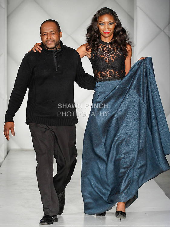 "Fashion designer Thomas LaVone, walks runway with model at the close of his Thomas LaVone Fall 2014 ""Era of the Woman"" collection fashion show, during Fashion Week Brooklyn Fall Winter 2014, day two at Industry City, on March 14, 2014."