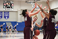 NWA Democrat-Gazette/CHARLIE KAIJO Rogers High School forward Gracie Carr (1) tries to control the ball as Siloam Springs High School defenders block, during the Great 8 Tournament, Thursday, November 29, 2018 at King Arena at Rogers High School in Rogers.