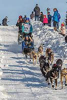 Jessica Klejka on Cordova St. hill during the Anchorage start day of Iditarod 2018 on Cordova St. hill during the Anchorage start day of Iditarod 2019