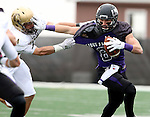 SIOUX FALLS, SD - OCTOBER 18: Josh Angulo #8 from the University of Sioux Falls tries to shake the grasp of Alex Oliver #4 from Southwest Minnesota State in the first half of their game Saturday afternoon at Bob Young Field in Sioux Falls. (Photo by Dave Eggen/Inertia)