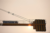 Daytime landscape view of a construction crane in the Heping District in Tiānjīn.  © LAN