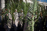 Rome, March 20, 2016. Alcune suore alla processione in Piazza San Pietro durante la celebrazione della Domenica delle Palme. Faithful hold palm fronds as they walk in procession prior to Palm Sunday Mass celebrated by Pope Francis, in St. Peter's Square, at the Vatican.