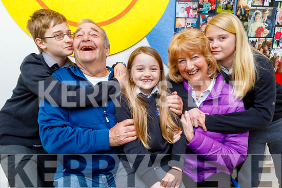 Jack, Sadie and Emma Lynch giving their grandparents David and Mary Sharp hugs and kisses at the Grandparents Day in  Scoil Nuachabháil on Friday.