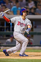 Ryan Goins (10) of the Buffalo Bisons follows through on his swing against the Charlotte Knights at BB&T Ballpark on May 9, 2014 in Charlotte, North Carolina.  The Knights defeated the Bisons 5-3.  (Brian Westerholt/Four Seam Images)