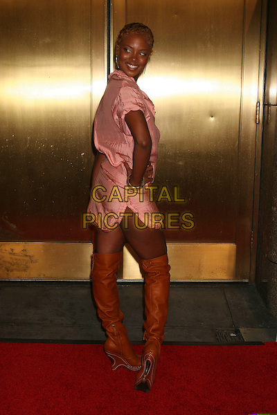 EVA PIGFORD.Arrivals at Fashion Rocks held at Radio City Music Hall,.New York, 8th September 2005.full length pink dress brown tan leather belt knee boots over shoulder back.Ref: IW.www.capitalpictures.com.sales@capitalpictures.com.©Capital Pictures
