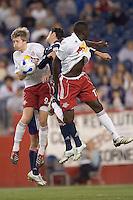 John Wolyniec (NY Red Bulls, white), Jay Heaps (NE Revolution, blue), and Josmer Altidore (NY Red Bulls, white) in a tangle. NE Revolution defeat New York Red Bulls, 1-0, at Gillette Stadium on Sept. 9, 2006.