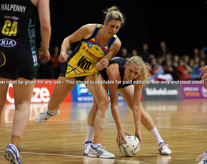 13.05.2013 Magic's Laura Langman and Pulse's Victoria Smith in action during the ANZ Champs netball match between the Magic and Pulse played at Claudelands Arena in Hamilton. Mandatory Photo Credit ©Michael Bradley.