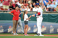 Buffalo Bisons third baseman Matt Hague (49) signs an autograph for a young fan during an on field promotion during a game against the Pawtucket Red Sox on August 26, 2014 at Coca-Cola Field in Buffalo, New  York.  Pawtucket defeated Buffalo 9-3.  (Mike Janes/Four Seam Images)