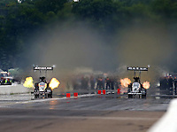Aug 17, 2014; Brainerd, MN, USA; NHRA top fuel dragster driver Shawn Langdon (right) races alongside Terry McMillen during the Lucas Oil Nationals at Brainerd International Raceway. Mandatory Credit: Mark J. Rebilas-