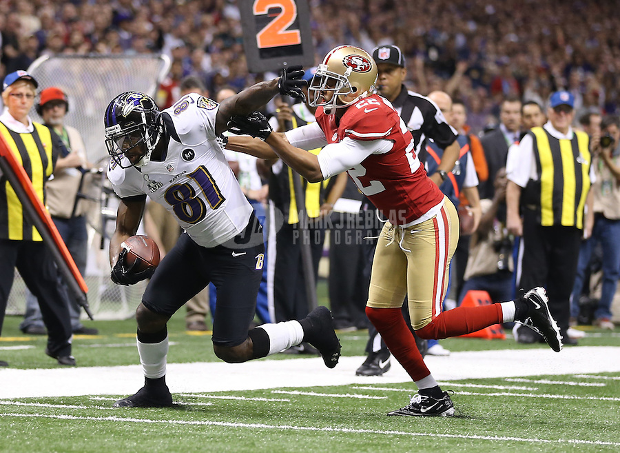Feb 3, 2013; New Orleans, LA, USA; Baltimore Ravens wide receiver Anquan Boldin (81) is tackled by San Francisco 49ers cornerback Carlos Rogers (22) in Super Bowl XLVII at the Mercedes-Benz Superdome. Mandatory Credit: Mark J. Rebilas-