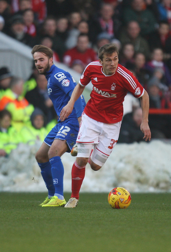Birmingham City's Andrew Shinnie (L) and Nottingham Forest's Robert Tesche in action during todays match  <br /> <br /> Photographer Jack Phillips/CameraSport<br /> <br /> Football - The Football League Sky Bet Championship - Nottingham Forest v Birmingham City - Saturday 28th December - The City Ground - Nottingham<br /> <br /> &copy; CameraSport - 43 Linden Ave. Countesthorpe. Leicester. England. LE8 5PG - Tel: +44 (0) 116 277 4147 - admin@camerasport.com - www.camerasport.com