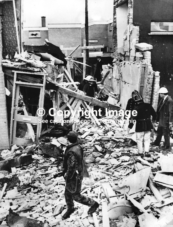 Firemen search through the debris of a house in Meenan Drive, Bogside,  Londonderry, in which two members of the Provisional IRA died on 28th November 1972. It is believed they were involved in  the assembly of a bomb. The IRA volunteers were John Brady, 21 years, and James Carr, 19 years, both of whom lived locally. The house where the explosion occured was that of Charles McSheffrey who was on remand at the time on an arms charge. Mr McSheefrey's wife was in a neighboour's house when the blast occured. 197212280123...Copyright Image from Victor Patterson, 54 Dorchester Park, Belfast, United Kingdom, UK...For my Terms and Conditions of Use go to http://www.victorpatterson.com/Victor_Patterson/Terms_%26_Conditions.html