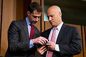 White House Legislative Director Marc Short, right, shows his cell phone to Senator Tom Cotton, Republican of Arkansas, left, prior to the confirmation hearing of Acting Director of the Central Intelligence Agency Gina Haspel to be CIA Director before the United States Senate Intelligence Committee on Capital Hill in Washington, DC on May 9, 2018. Credit: Alex Edelman / CNP