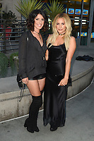 HOLLYWOOD, CA - JULY 25: Shenae Grimes and Ashley Tisdale at the Premiere Of Cinedigm's 'Amateur Night' at ArcLight Hollywood on July 25, 2016 in Hollywood, California. Credit: David Edwards/MediaPunch
