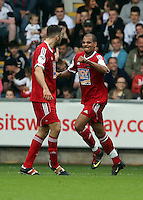 Pictured: Junior Harvey (R) celebrating one of his goals. Sunday, 01 June 2014<br />