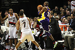 04/08/11--Lakers' Kobe Bryant saves a loose ball in front the Trailblazers' bench in Portland's 93-86 won over L.A. at the Rose Garden..Photo by Jaime Valdez........................................
