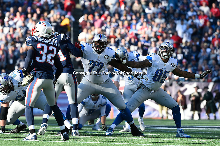 November 23, 2014 - Foxborough, Massachusetts, U.S.- Detroit Lions tackle Cornelius Lucas (77) New England Patriots outside linebacker Jamie Collins (91) during a field goal attempt at the NFL game between the Detroit Lions and the New England Patriots held at Gillette Stadium in Foxborough Massachusetts. The Patriots defeated the Lions 34-9. Eric Canha/CSM