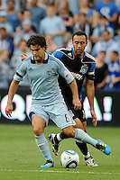 Graham Susi (8) Sporting KC midfielder shields the ball from Ramiro Corrales San JoseEarthquakes...Sporting KC defeated San Jose Earthquakes 1-0 at LIVESTRONG Sporting Park, Kansas City ,Kansas,..