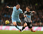 Aleksander Kolarov of Manchester City tackled by Daryl Janmaat of Newcastle United - Barclays Premier League - Manchester City vs Newcastle Utd - Etihad Stadium - Manchester - England - 21st February 2015 - Picture Simon Bellis/Sportimage