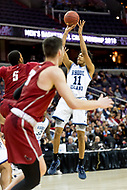 Washington, DC - MAR 10, 2018: Rhode Island Rams guard Jeff Dowtin (11) goes up for a jump shot during the semi final match up of the Atlantic 10 men's basketball championship between Saint Joseph's and Rhode Island at the Capital One Arena in Washington, DC. (Photo by Phil Peters/Media Images International)