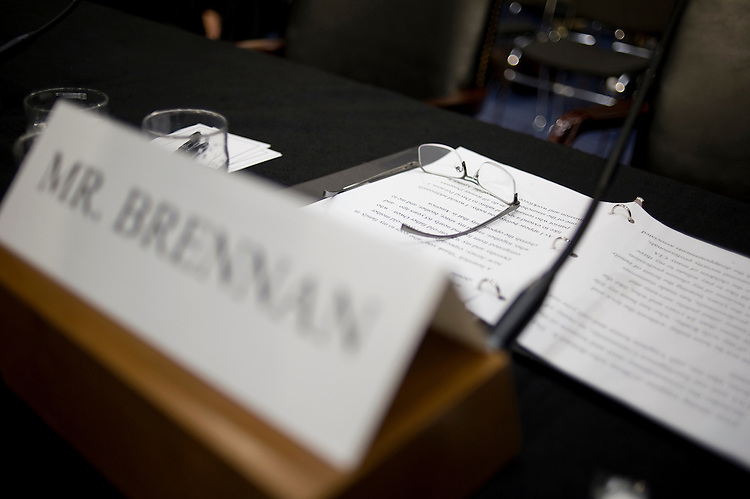 UNITED STATES - FEBRUARY 7: U.S. Assistant to the President for Homeland Security and Counterterrorism John Brennan left his glasses after leaving the Senate Intelligence Committee for his nomination to be the next Director of the Central Intelligence Agency. The room was cleared of the general public after numerous protesters continue to disrupt the hearing. Brennan is expected to face harsh questioning the drone targeted killing program. (Photo By Chris Maddaloni/CQ Roll Call)