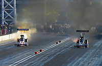 Oct. 27, 2012; Las Vegas, NV, USA: NHRA top fuel driver Antron Brown (left) alongside Steve Torrence during qualifying for the Big O Tires Nationals at The Strip in Las Vegas. Mandatory Credit: Mark J. Rebilas-