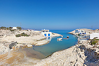 "Traditional fishermen houses with the impressive boat shelters, also known as ""syrmata"" in Agios Konstantinos of Milos, Greece"