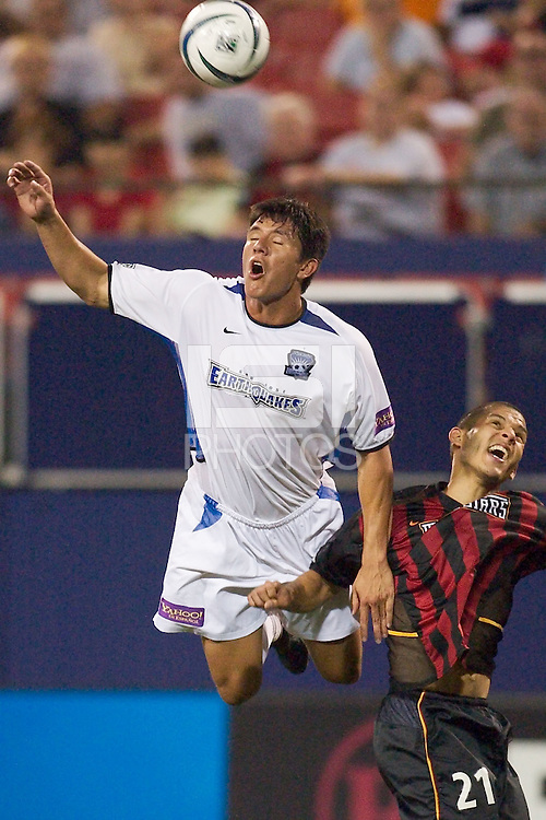 Brian Ching of the Eathquakes goes up for a header over Craig Ziadie of the MetroStars. Ching had two goals for the game. The San Jose Earthquakes and the the NY/NJ MetroStars played to a 4-4 tie on 7/02/03 at Giant's Stadium, NJ..