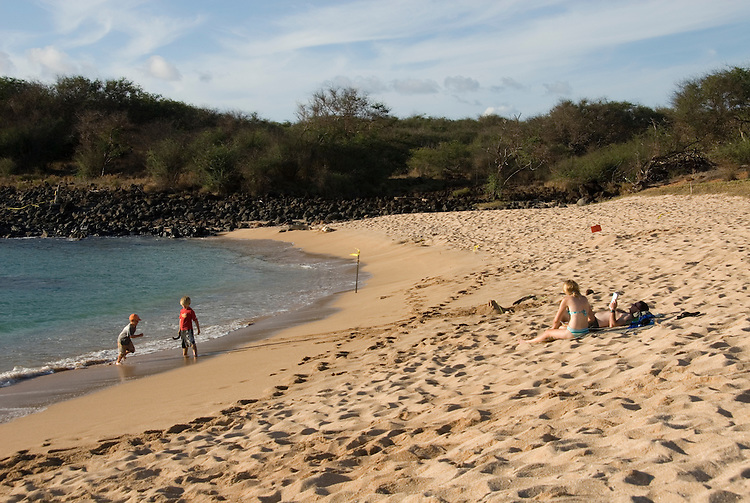 Hawaii: Molokai, beach at Kaupoa, part of The Lodge at Molokai Ranch.  Family on the beach..Photo himolo201-71929..Photo copyright Lee Foster, www.fostertravel.com, lee@fostertravel.com, 510-549-2202