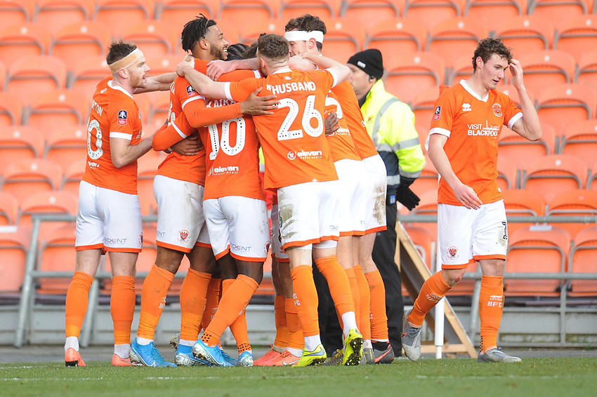 Blackpool's Nathan Delfouneso is mobbed by team-mates as he celebrates scoring his side's third goal  <br /> <br /> Photographer Kevin Barnes/CameraSport<br /> <br /> Emirates FA Cup Second Round - Blackpool v Maidstone United - Sunday 1st December 2019 - Bloomfield Road - Blackpool<br />  <br /> World Copyright © 2019 CameraSport. All rights reserved. 43 Linden Ave. Countesthorpe. Leicester. England. LE8 5PG - Tel: +44 (0) 116 277 4147 - admin@camerasport.com - www.camerasport.com