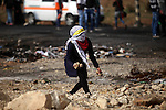 A female Palestinian protester throws stones towards Israeli security forces during clashes following the funeral of Ahmed Abu al-Aish, 28, and Laith Manasrah, 21, in Beit El on the outskirts of the West Bank city of Ramallah, Nov. 16, 2015. Two Palestinians were killed and three wounded in clashes with Israeli troops early Monday in a Palestinian refugee camp in the Jerusalem area, a Palestinian health official said. The Israeli military said its troops entered Qalandia to demolish the home of a Palestinian who it says shot and killed an Israeli motorist in the West Bank this summer after he stopped to give the Palestinian directions to a nearby spring. Photo by Shadi Hatem