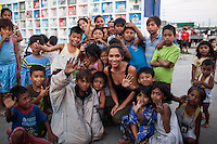 UK celebrity Myleene Klass poses for a group portrait with children who live in a cemetery in Paranaque City, Metro Manila, The Philippines on 18 January 2013. Photo by Suzanne Lee for Save the Children UK
