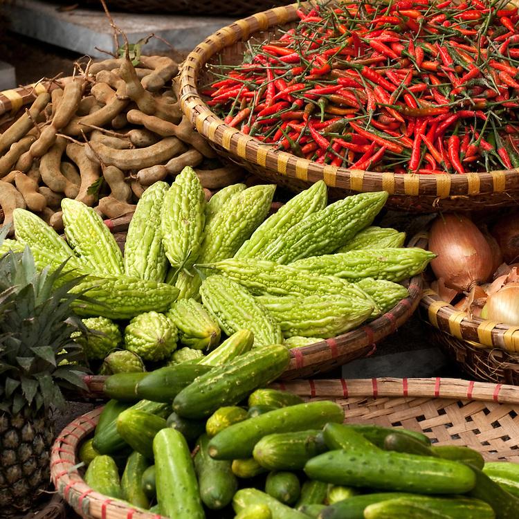 Baskets of chillies, bitter melons and tamarinds, Nguyen Thien Thuat St, near Cho Dong Xuan market, Hanoi Old Quarter, Vietnam
