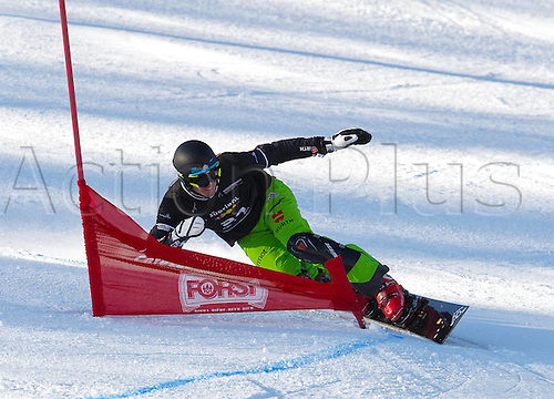 13.12.2013  CAREZZA, ITALY. Mens SNOWBOARD FIS World cup Parallel. Patrick Bussler (GER).