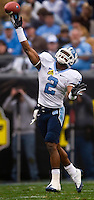 North Carolina wide receiver Cooter Arnold (2) throws a pass against West Virginia during the Meineke Car Care Bowl college football game at Bank of America Stadium in Charlotte, NC.